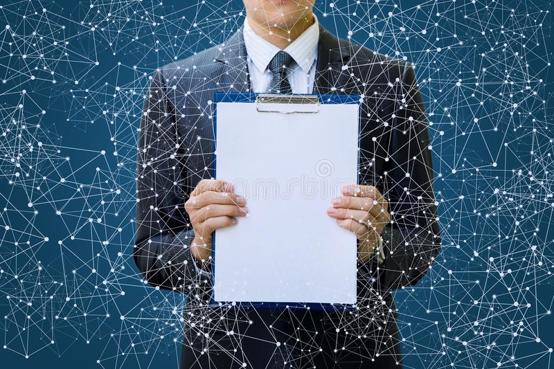 Check list in the hands of a businessman . Check list in the hands of a businessman in network connections stock photo