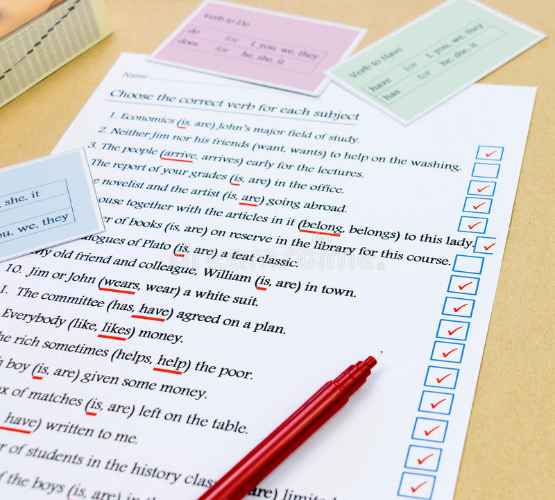 Check mark box next to english exercise. Blue check mark box next to english sentence on white exercise sheet royalty free stock photo