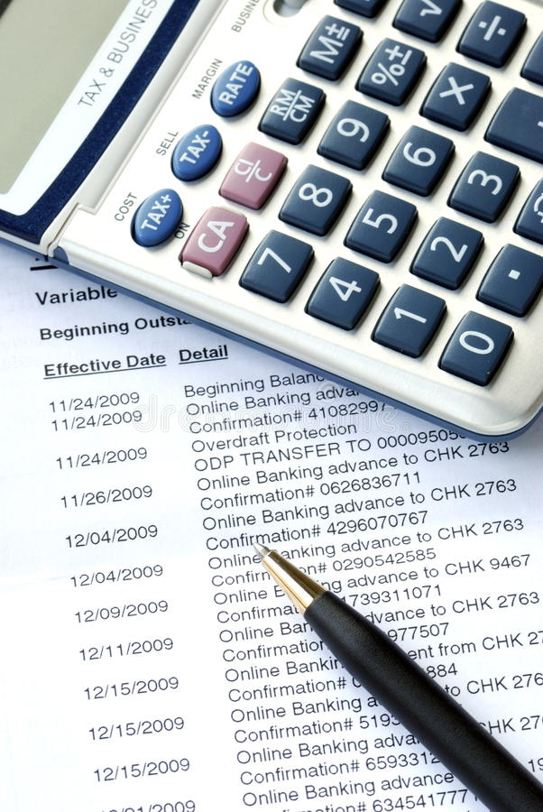 Check the monthly bank account statement. Carefully check the monthly bank account statement stock image