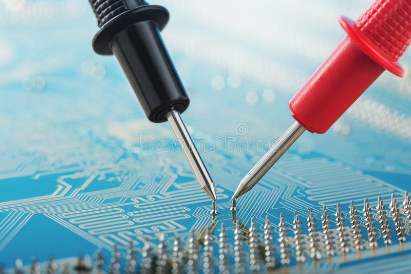 Check by multimeter, electronic circuit board of digital device with components. Troubleshooting in the electronic device. Check by multimeter, electronic stock photo