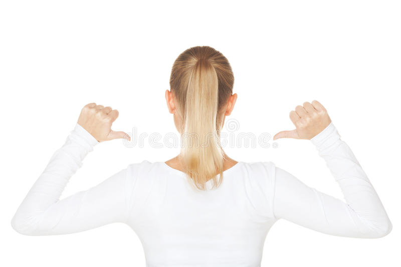 Check my text. Girl showing text on the back side of t-shirt on isolated white stock photos
