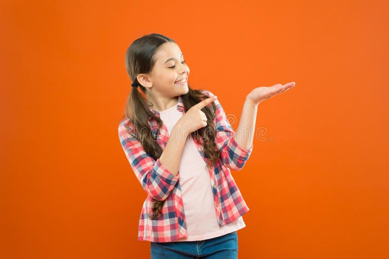 Check this out. Product presentation. Kid happy face show something copy space. Girl demonstrate product. Commercial. Advertisement. Promotion concept stock image