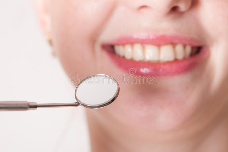 Check the teeth. Open mouth of woman with dentist mirror during checking teeth royalty free stock photo