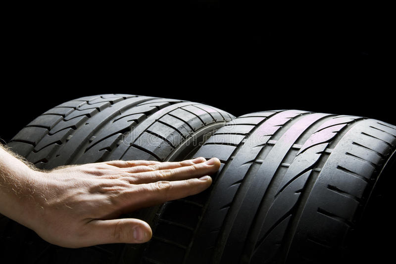 Check tires. Checking and compare used and worn tires royalty free stock images