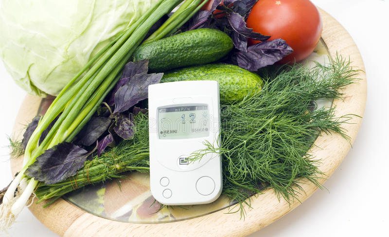 Check of vegetables on radiation presence stock photography