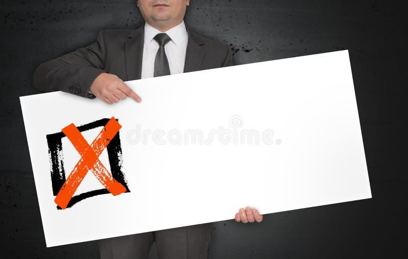 Checkbox de affiche wordt gehouden door zakenman stock foto