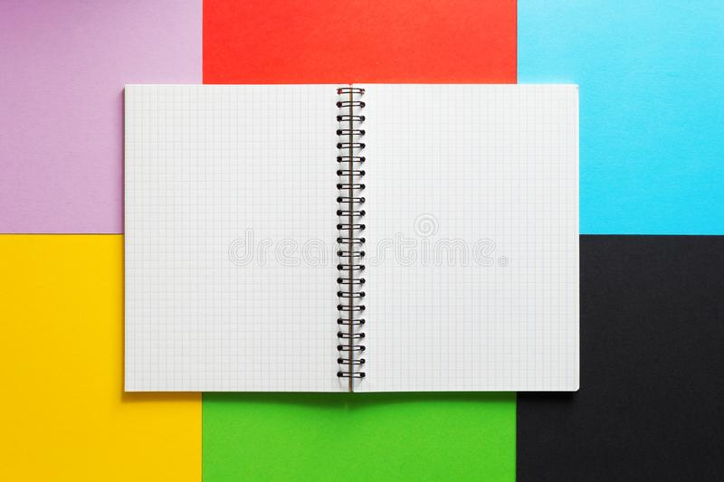 Checked notebook at abstract colorful paper royalty free stock photos