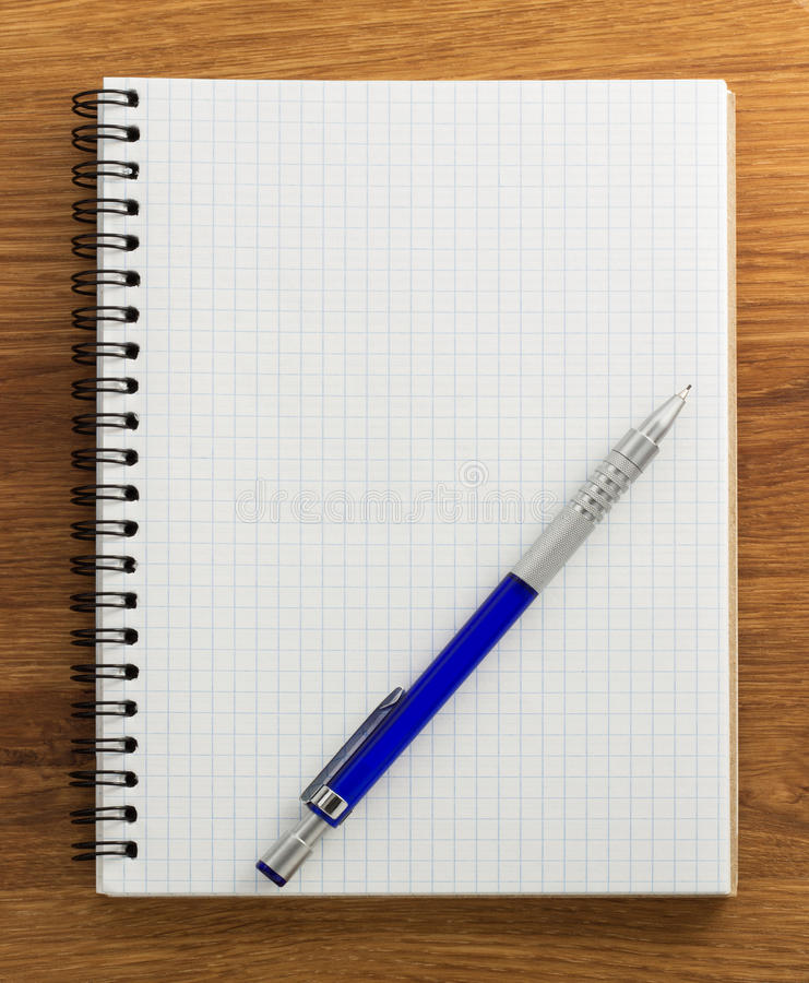 Download Checked notebook on wood stock image. Image of background - 39503849