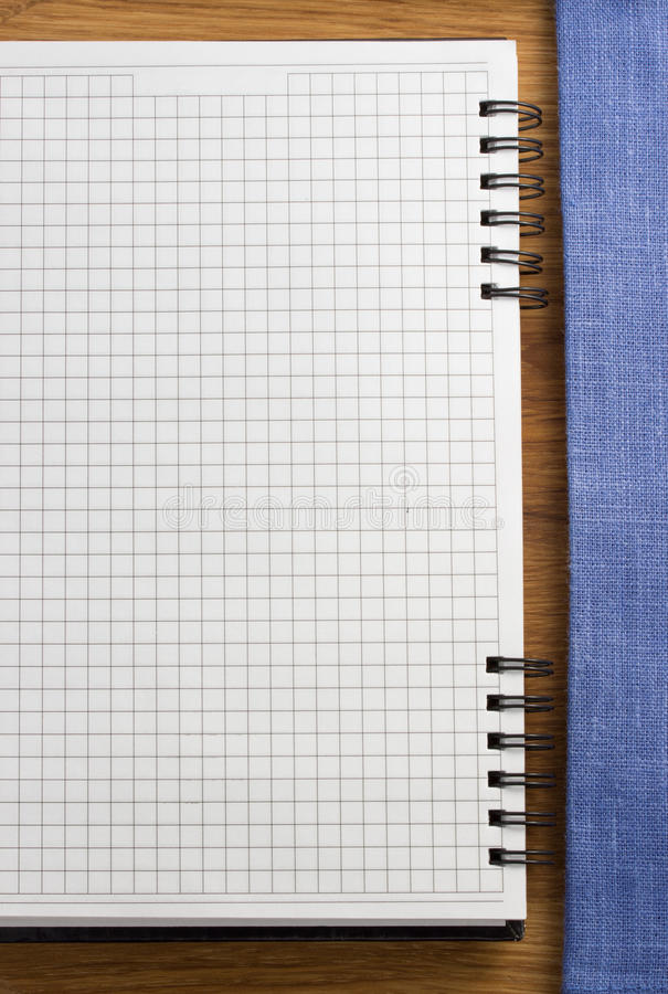 Download Checked notebook on wood stock image. Image of border - 39503847