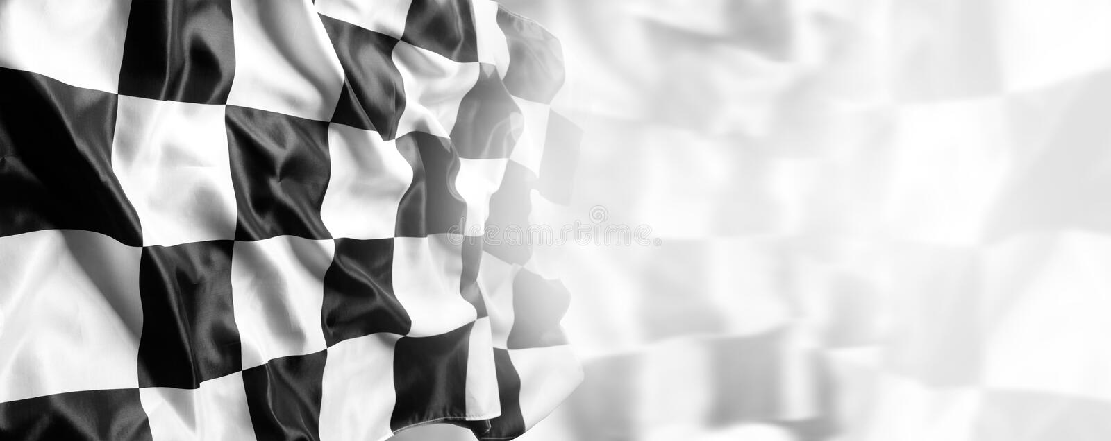 Checkered flag. Checkered black and white racing flag stock photography