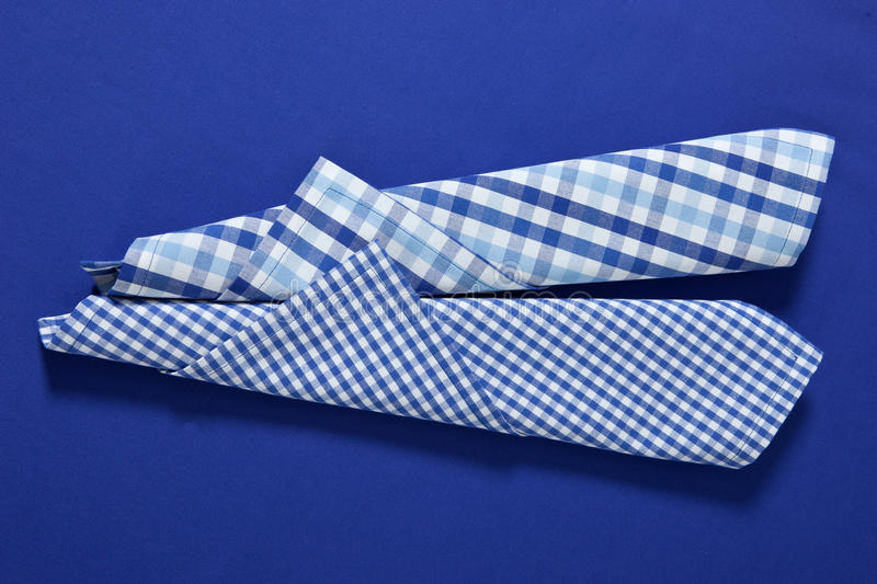 Checkered blue and white clothes on blue royalty free stock photo