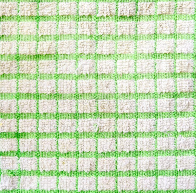Checkered fragment of cloth texture. Checkered green and white fragment of cloth texture stock image