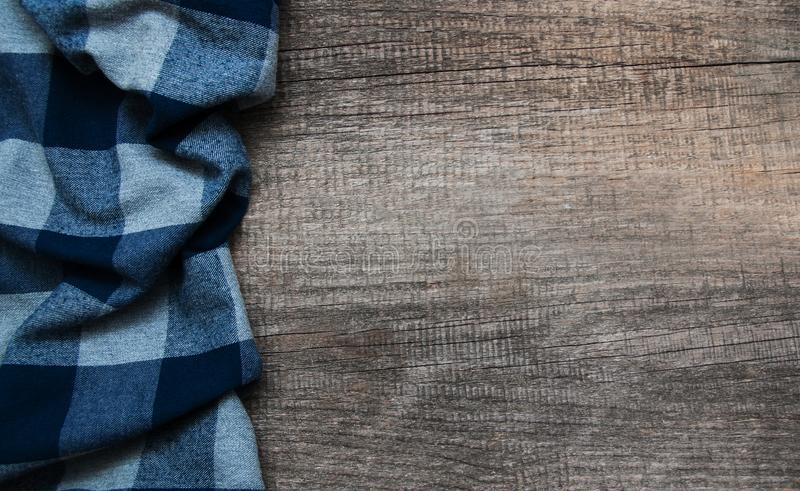 Checkered Napkin On A Wooden Background Stock Image