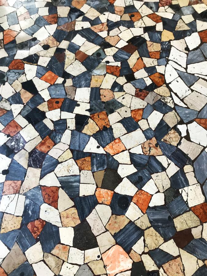 Checkered patchwork floor as pavement in Rome, Italy. stock photo