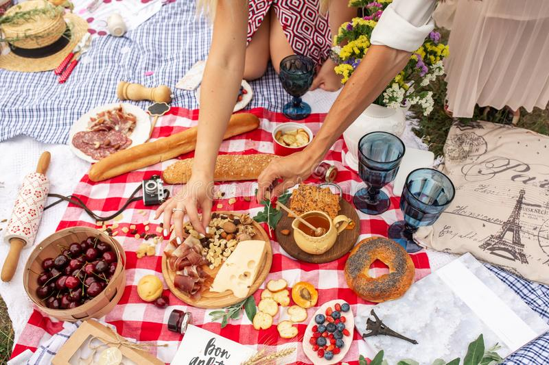 Checkered picnic blanket in french style with foods and sign says bon appetit.  stock photography