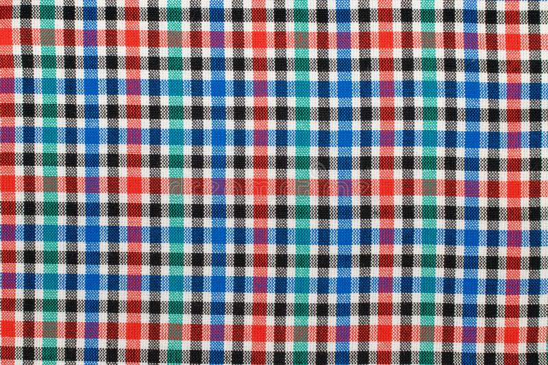 Checkered plaid fabric background. Texture of red blue green plaid fabric cloth royalty free stock image