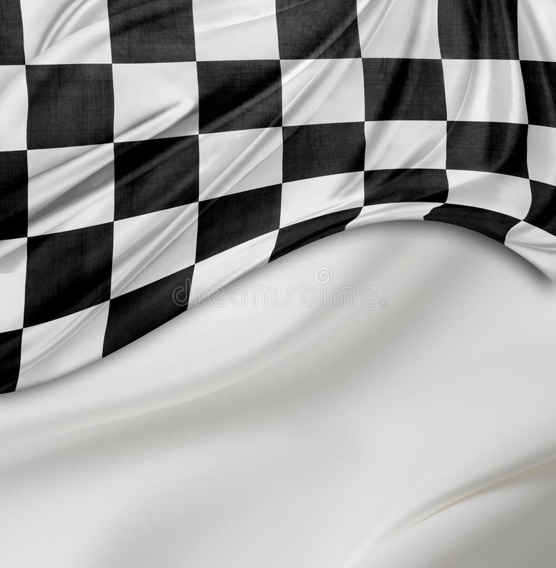 Checkered racing flag. Checkered black and white racing flag on white silky background stock photography