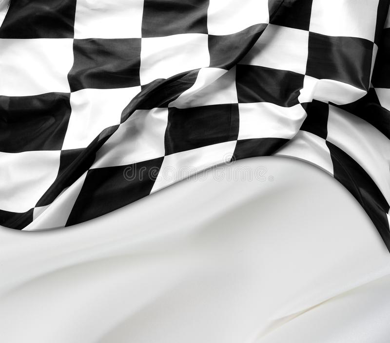 Checkered racing flag. Checkered black and white racing flag on white silky background royalty free stock images