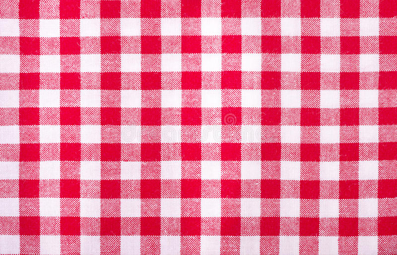 Checkered red and white tablecloth. Background stock photo