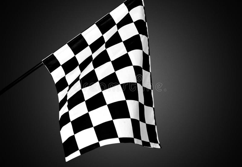 Checkered waving flag on background. Concept photo. Flag waving check checkered checker chequered flag car racing royalty free stock photo