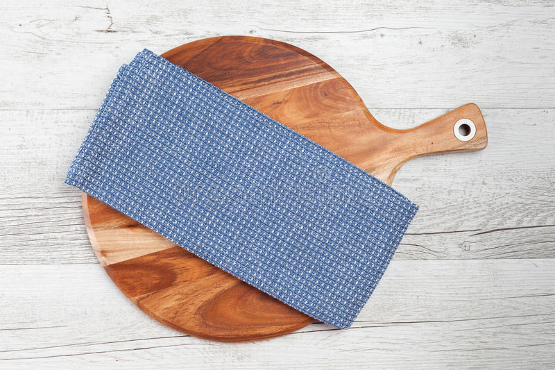 Checkered white blue kitchen towel on white rustic wooden background. stock photos