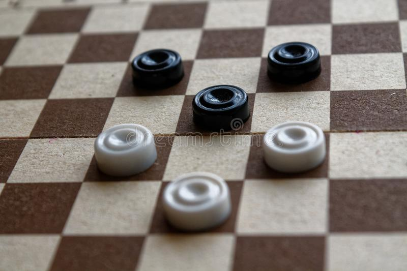 Checkers in checkerboard reday for playing. Game concept. Board game. Hobby. checkers on the playing field for a game. Checkers in checkerboard ready for royalty free stock images