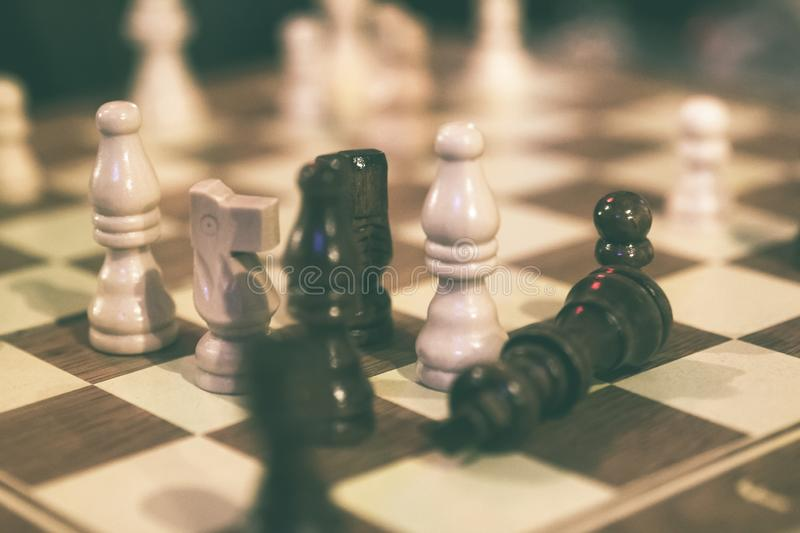 Checkers during a chess game. Wooden checkers used during a game of chess royalty free stock photography