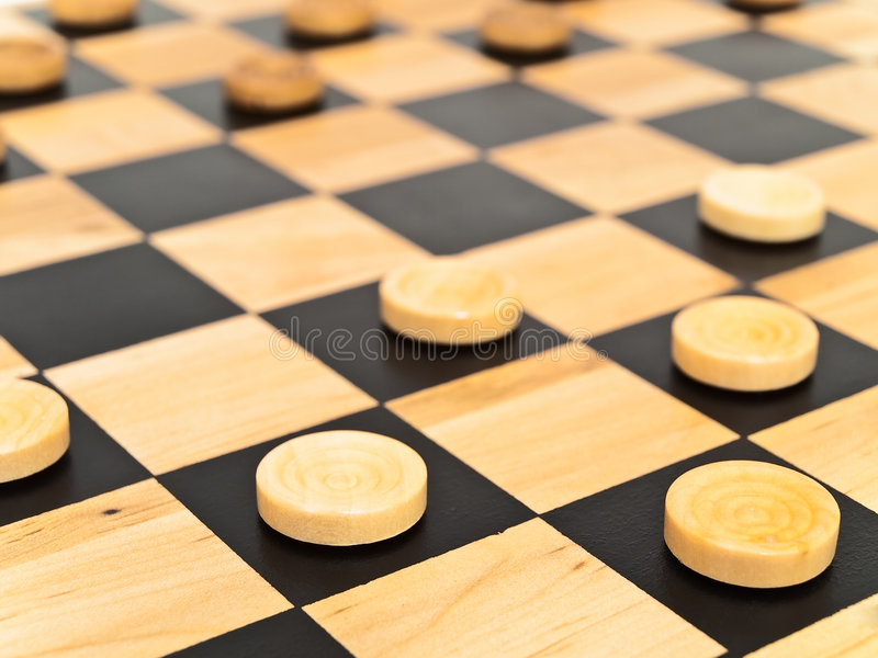 Checkers in game. Photo of the checkers game stock photos