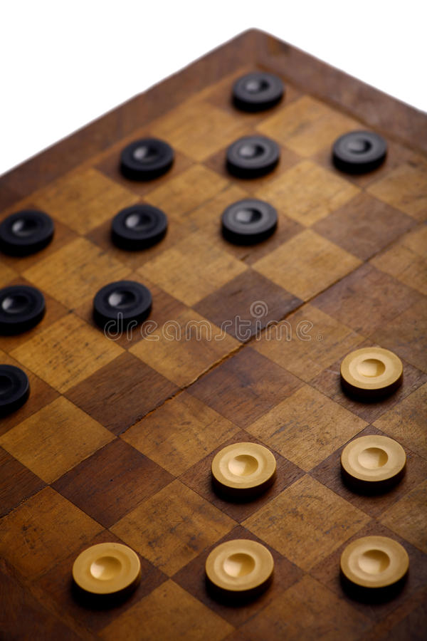 Checkers game. Color shot of a vintage draughts or checkers board game royalty free stock images