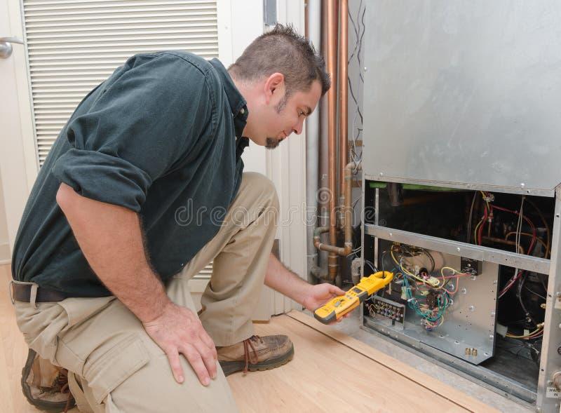 Checking Air Conditioner Amps stock photos