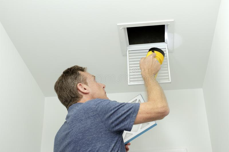 Checking Air Ducts in Home HVAC System royalty free stock photo