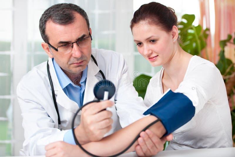 Download Checking  blood pressure stock image. Image of examining - 26296575