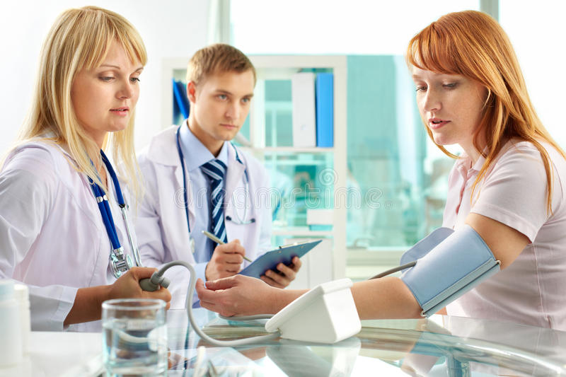 Download Checking blood pressure stock photo. Image of interacting - 28363128