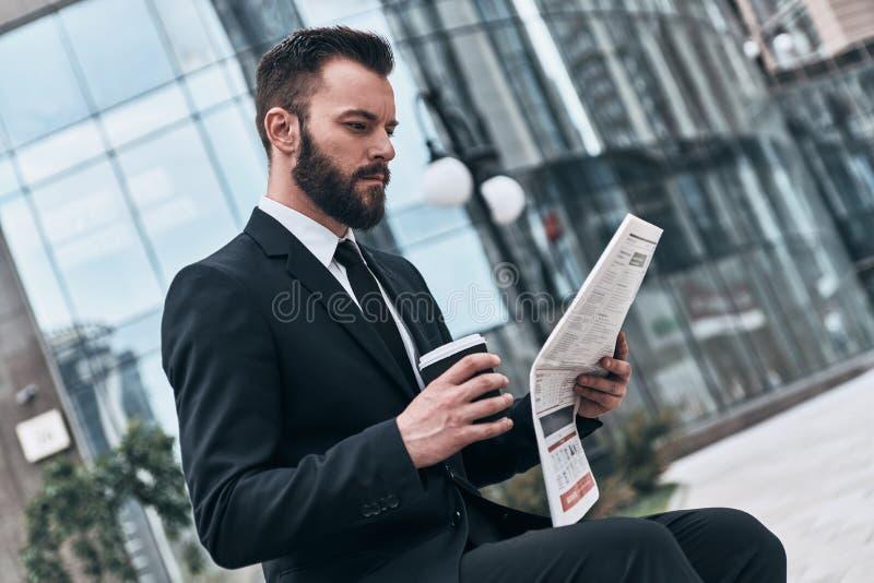 Checking business news. stock photo