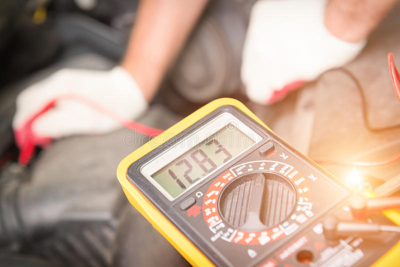 Checking car battery voltage stock image