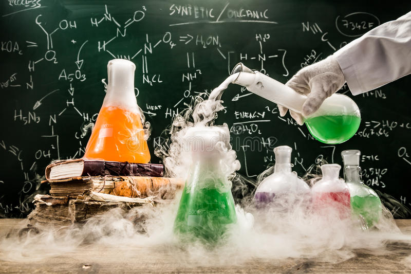 Checking the chemical formula in academic laboratory stock image