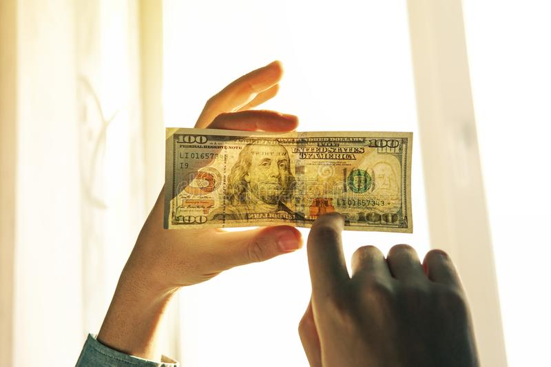 Checking counterfeit money light. stock image