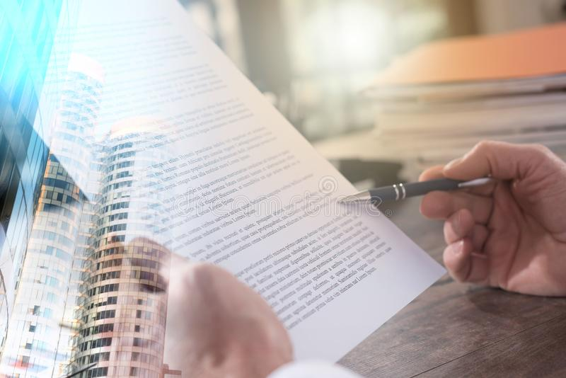 Checking a document (Lorem ipsum text used). multiple exposure stock photography