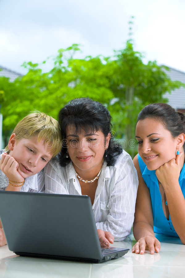 Checking e-mail. Portrait of happy family getting busy with laptop royalty free stock image