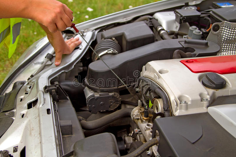 Checking engine oil. Details checking engine oil dipstick in car royalty free stock photography