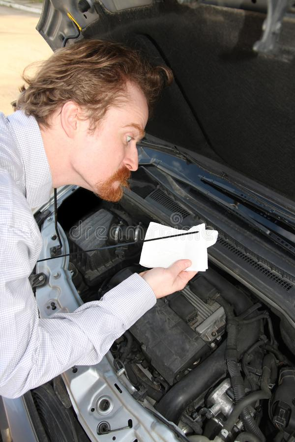 Checking engine oil dipstick royalty free stock photo