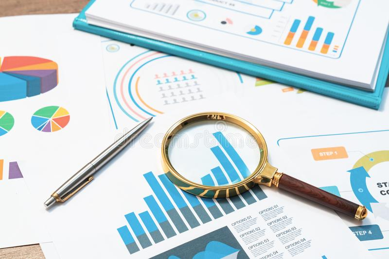 Checking financial reports. Graphs and charts. Documents and mag stock image