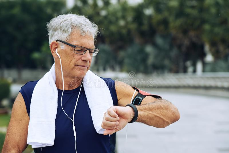 Checking fitness tracker stock images