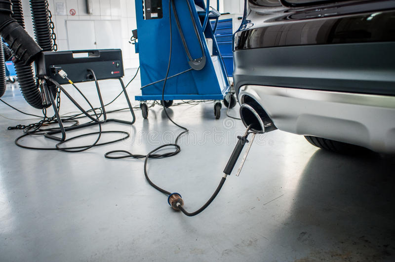 Checking gas emission car. In the workshop checking gas emission car royalty free stock images