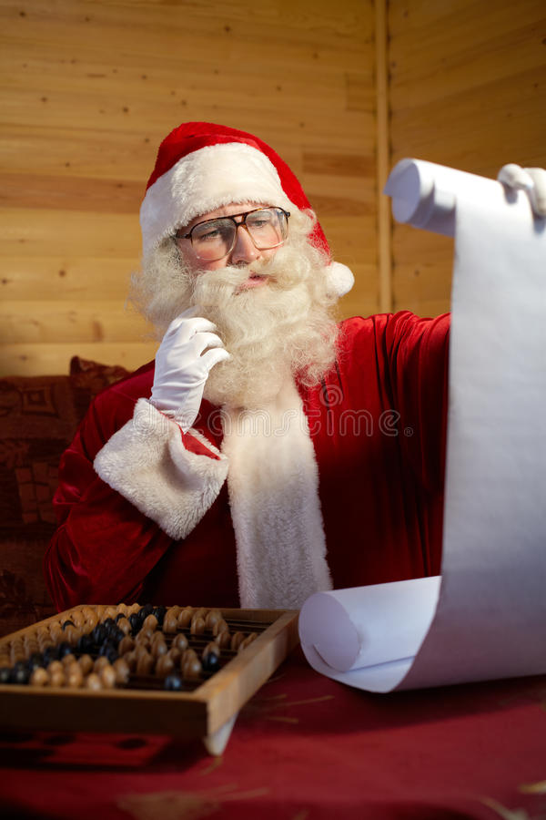 Checking gift list royalty free stock photo