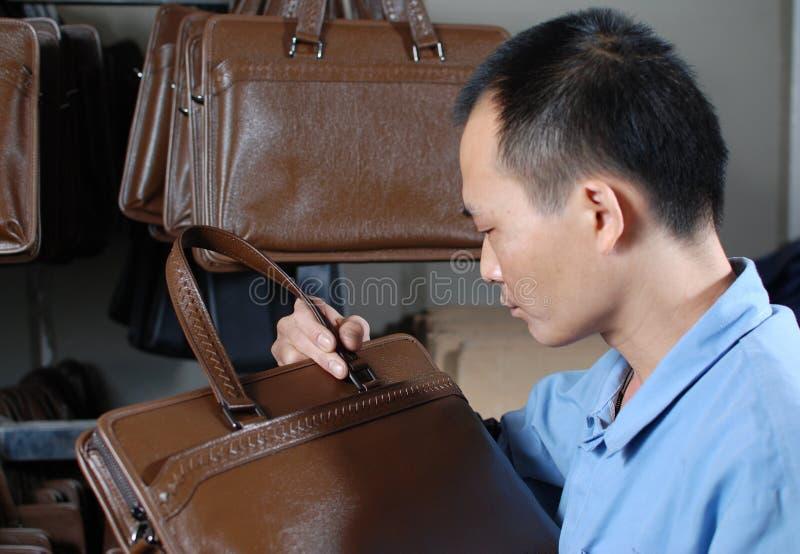 Checking the handbag royalty free stock photo