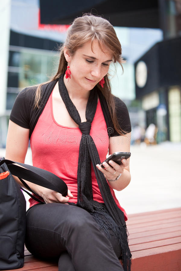 Download Checking her messages stock image. Image of store, stores - 9745359