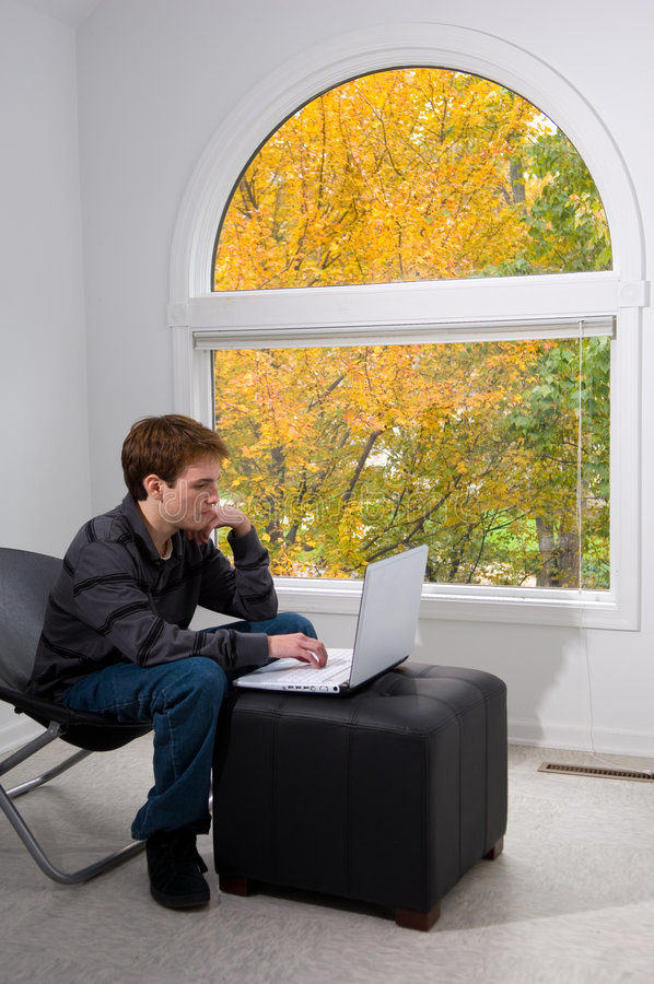 Download Checking his email stock photo. Image of foliage, casual - 1415456