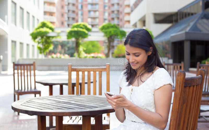Checking messages on phone stock image