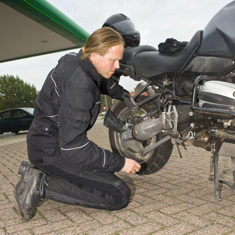 Checking a motorcycle royalty free stock photos